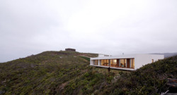 MODERN WHITE HOUSE ON A CLIFF WITH DRAMATIC SEA VIEWS